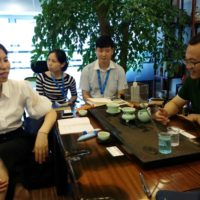 Ms. Wang Pu. BluGreen_s GM China is on the left